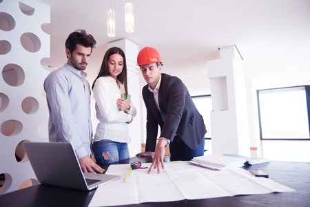home business: happy young family,  couple buying new home with real estate agent, people group interior