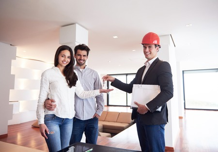 home sale: happy young family,  couple buying new home with real estate agent, people group interior