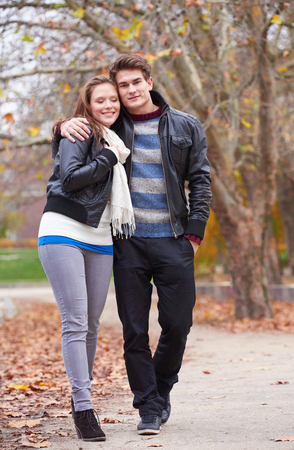 autumn young: romantic young couple have fun in city park at autumn season Stock Photo