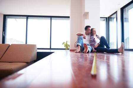 house moving: happy young romantic couple at new modern  home interior renovation Stock Photo