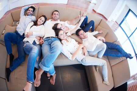 livingroom: portrait of happy young group of friends get releax and have fun at modern home interior, top view