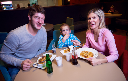family together have break at lunch in shopping mall