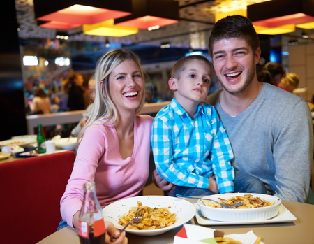 family together: family together have break at lunch in shopping mall
