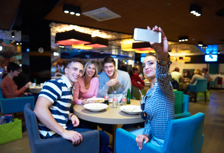 mall: friends have lanch break in shopping mall, eating italian fast food