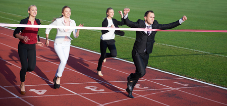 business people running together on  athletics racing track Stock Photo