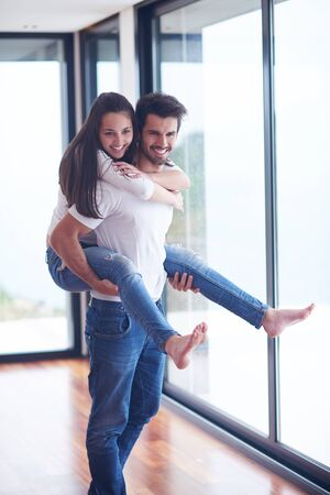 livingroom: happy young romantic couple have fun relax smile at modern home livingroom interior Stock Photo