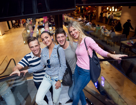 casual fashion: group of happy  friends in shopping mall have fun Stock Photo