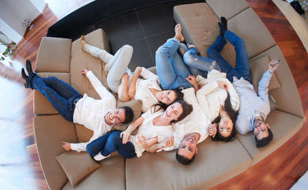 people relax: portrait of happy young group of friends get releax and have fun at modern home interior, top view
