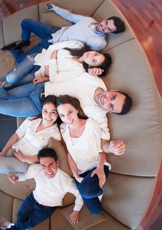 young group: portrait of happy young group of friends get releax and have fun at modern home interior, top view