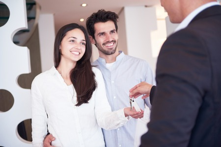 real business: happy young family,  couple buying new home with real estate agent, people group interior