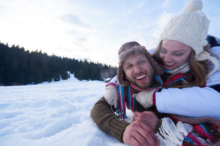 white winter: portrait of happy young romantic tourist  couple outdoor in nature at winter vacation Stock Photo