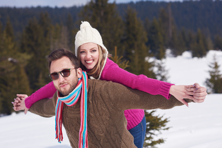 couple nature: portrait of happy young romantic tourist  couple outdoor in nature at winter vacation Stock Photo