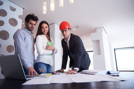 engineer: happy young family,  couple buying new home with real estate agent, people group interior