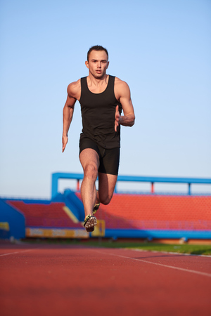 starting blocks: Sprinter leaving starting blocks on the running track. Explosive start. Stock Photo