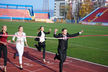 businesspeople: business people running together on  athletics racing track Stock Photo