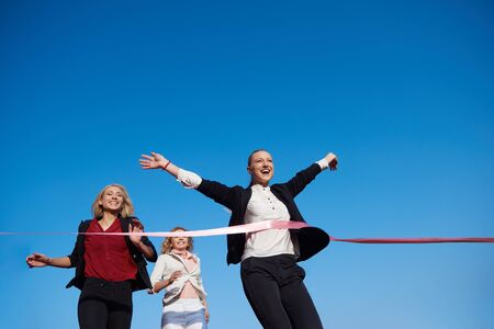 athletics track: business people running together on  athletics racing track Stock Photo
