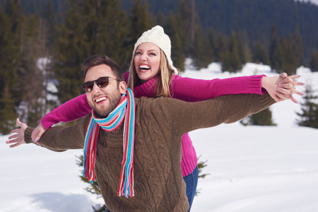 romantic couple: portrait of happy young romantic tourist  couple outdoor in nature at winter vacation Stock Photo