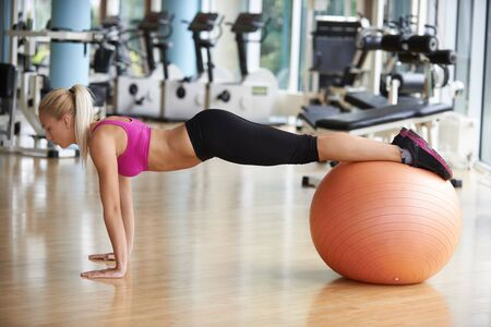 WOMAN FITNESS: woman exercise pilates in fitness gym club