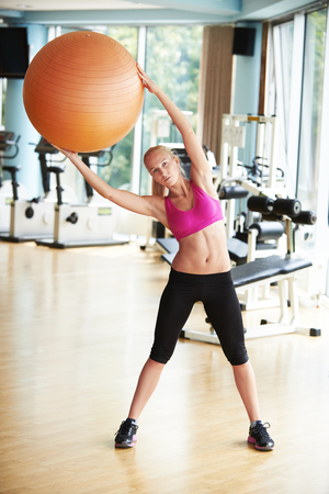 fitness gym: woman exercise pilates in fitness gym club