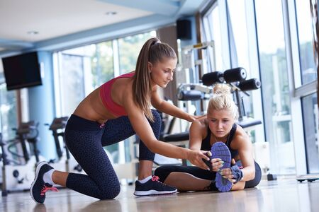 pilates: woman exercise and  working out with fitness personal trainer in gym