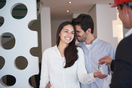 deal: happy young family,  couple buying new home with real estate agent, people group interior