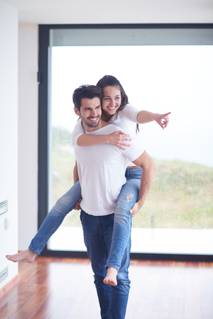 diverse family: happy young romantic couple have fun relax smile at modern home livingroom interior Stock Photo