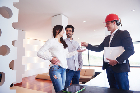 young happy couple: happy young family,  couple buying new home with real estate agent, people group interior