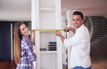 renovating: happy young romantic couple at new modern  home interior renovation Stock Photo