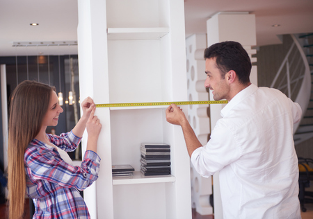 home working: happy young romantic couple at new modern  home interior renovation Stock Photo