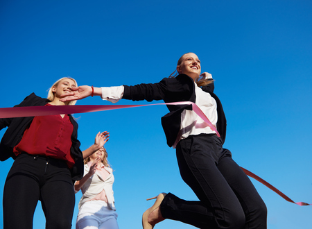 executive women: business people running together on  athletics racing track Stock Photo