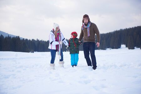 happy family nature: happy young  family playing in fresh snow  at beautiful sunny winter day outdoor in nature