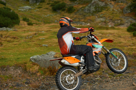 enduro: amateur motocross drivers have hobby ride on mountains road