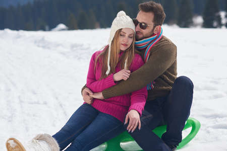 vacation: portrait of happy young romantic tourist  couple outdoor in nature at winter vacation Stock Photo