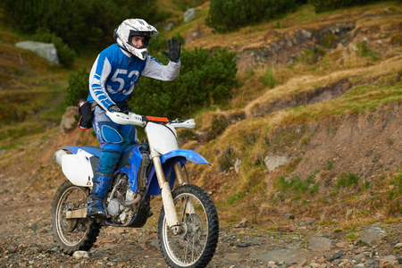 amateur: amateur motocross drivers have hobby ride on mountains road