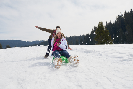 romantic winter  scene, happy young couple having fun on fresh show on winter vacatio, mountain nature landscape Stock Photo