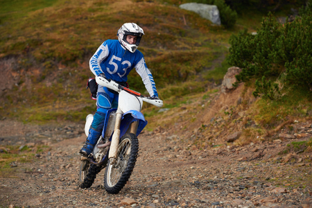motor cycle: amateur motocross drivers have hobby ride on mountains road