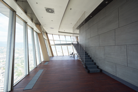 empty room: modern bright empty office or living room  interior with big windows and stairs