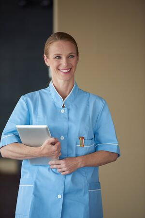 doctor female: portrait of female doctor with  tablet computer at hospital Stock Photo