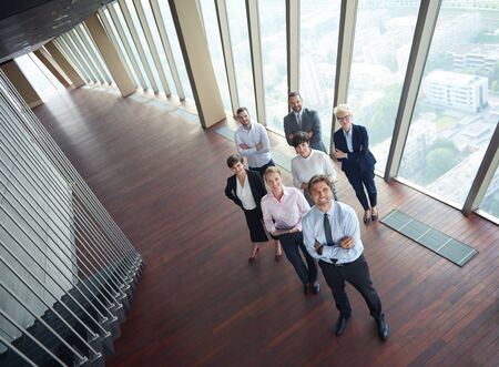 businessman in office: diverse business people group standing together as team  in modern bright office interior