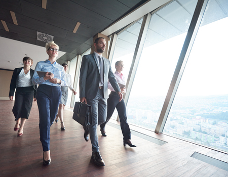 staff team: business team, businesspeople  group walking at modern bright office interior Stock Photo