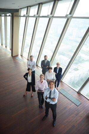 group meeting: diverse business people group standing together as team  in modern bright office interior