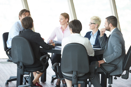 executive women: young business people group have meeting and working in modern bright office indoors