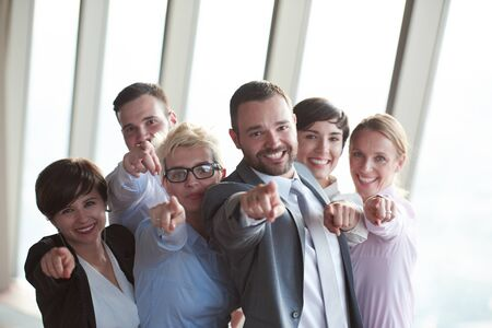 personas de pie: diverse business people group standing together as team  in modern bright office interior