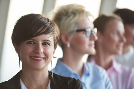 woman business suit: diverse business people group standing together as team  in modern bright office interior