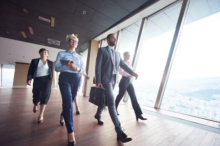 working team: business team, businesspeople  group walking at modern bright office interior Stock Photo