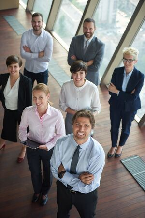 businesspeople: diverse business people group standing together as team  in modern bright office interior