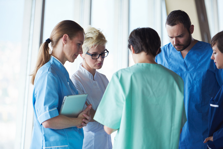 work together: group of medical staff at hospital, doctors team standing together