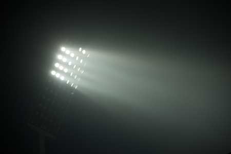 spotlight: soccer stadium lights reflectors against black background