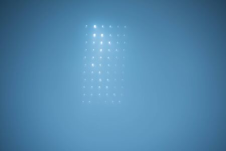 blue and white: soccer stadium lights reflectors against black background