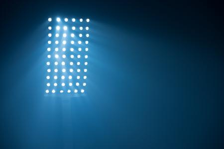 floodlit: soccer stadium lights reflectors against black background